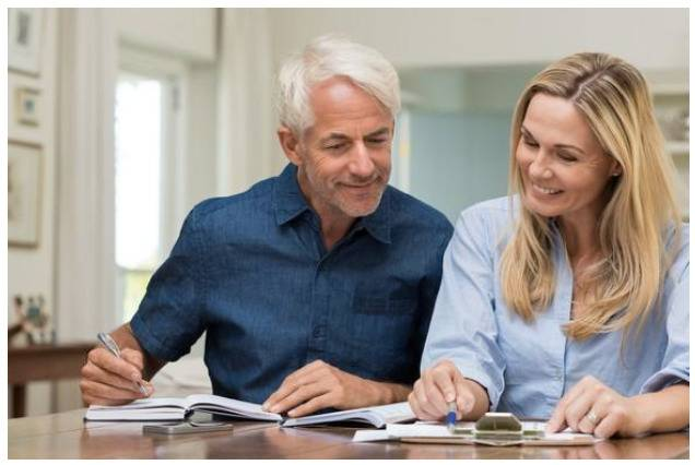 image of man and woman for blog post Money Management for Couples: Taking Responsibility for True Measure Wealth Management