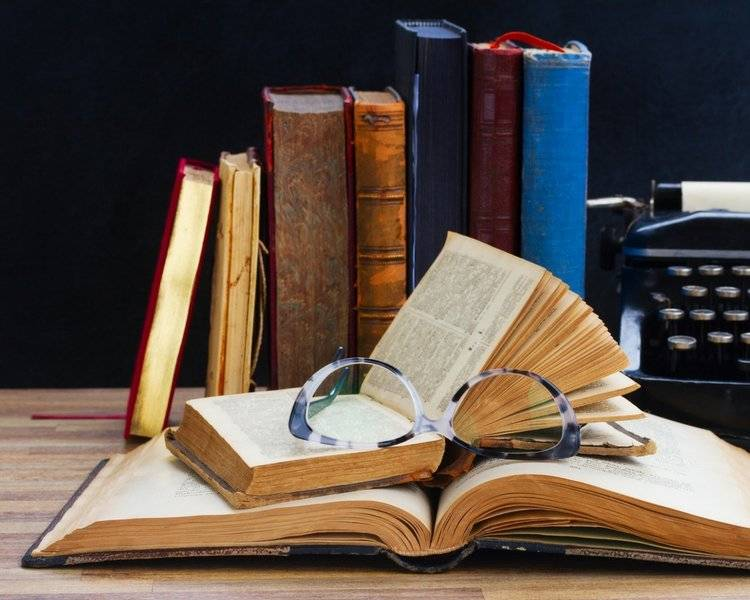 Image of books. From the Always Look At Your Advisor's Bookshelf blog post. True Measure Wealth Management Blog